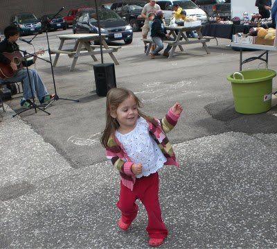 Preschooler dancing to the live music at the Windsor Ontario Farmers Market