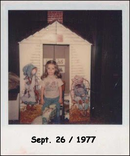 Vintage polaroid photo of preschooler with Holly Hobbie playhouse.