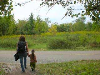 Grandma on a nature walk with preschooler.