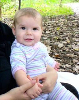 Baby at picnic in the woods.