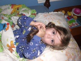 Preschooler sucking her thumb at bedtime.