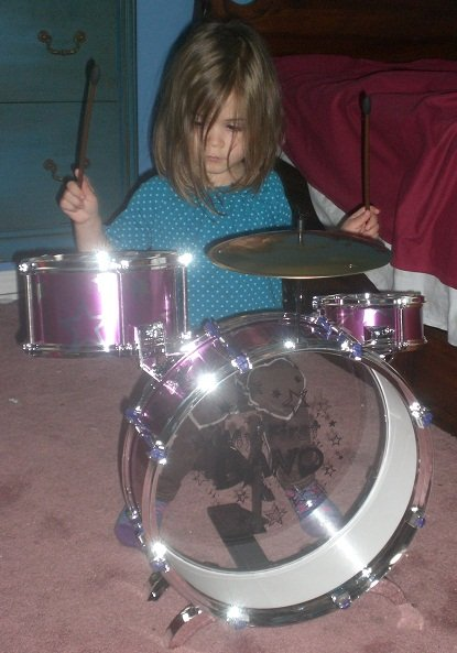 My 4 year old daughter drumming