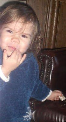 Happy Toddler eating Kelloggs Mini Wheats