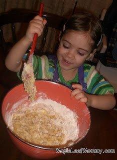 Preschooler mixing banana bread batter.
