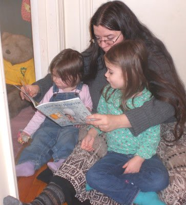 Reading 'I'll Love You Forever' to my daughters.