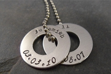 Personalized handstamped necklace featuring children's names and date of bith.