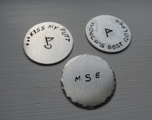 Handcrafted personalized golfball markers.