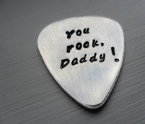 Personalized handstamped guitar pick.
