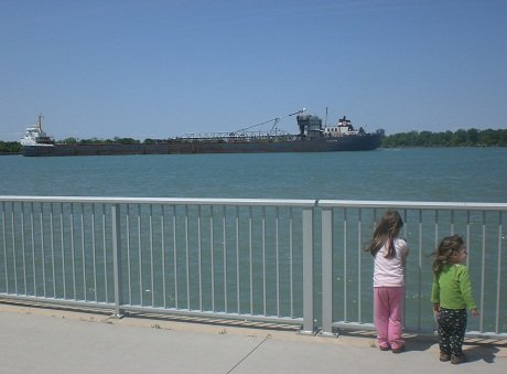 Preschoolers watching freighter boat go by.