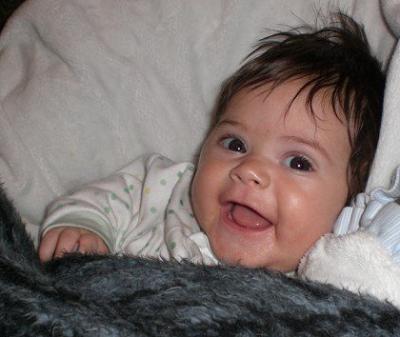 Joyous, happy infant girl smiling.