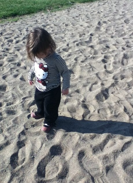My preschooler playing in the sand at the park.