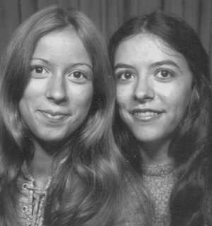 Two long haired sisters in the 70s.
