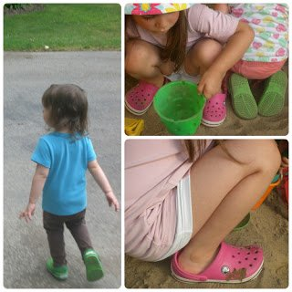 Playing in the sandbox in their crocs.