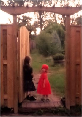 Two sisters stand at the gateway to fairyland.