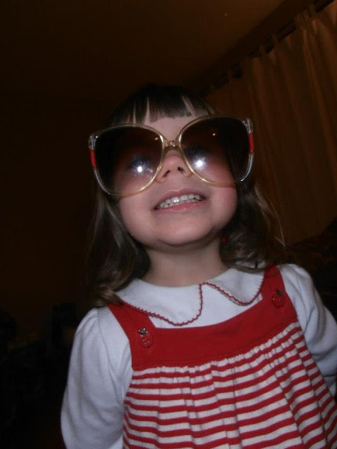 Silly preschooler in shades.