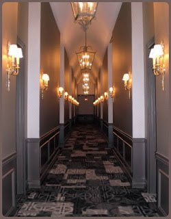 Grand looking hallway with fancy light fixtures.