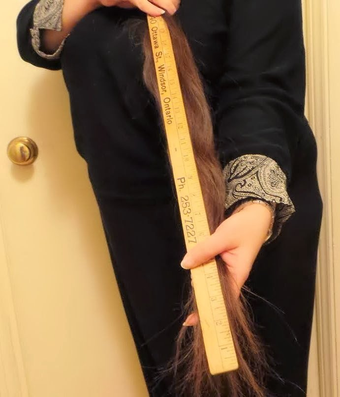 Measuring 43 inches of hair.