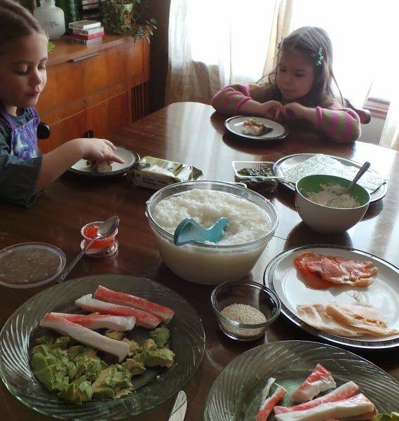Kids making sushi.