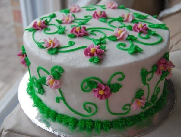 Cake covered in icing flowers.