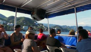 Riding a tour boat in the waters off Puerto Vallarta.