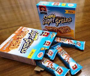 Quakers New Chewy Super Grains granola bars in Chocolate & Honey varieties.
