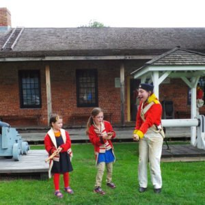 Children learning to load a musket at Fort Malden.