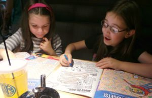 Happy kids coloring at Boston Pizza.