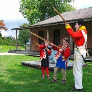 Bang, bang, firing muskets like a British soldier.