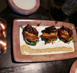 chocolate covered bacon topped pork belly sliders at Toothsome Orlando