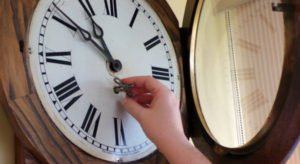 old-clock-being-wound