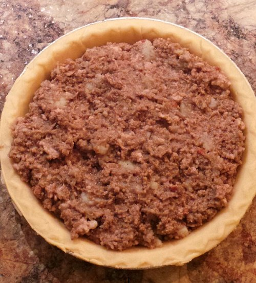 meat pie ready for top crust