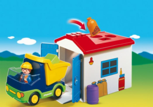 Preschooler Playmobil construction truck and shed.